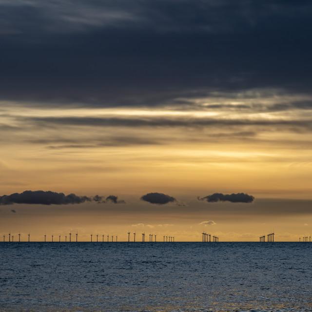 """""""Renewable energy off the coast at dusk"""" stock image"""