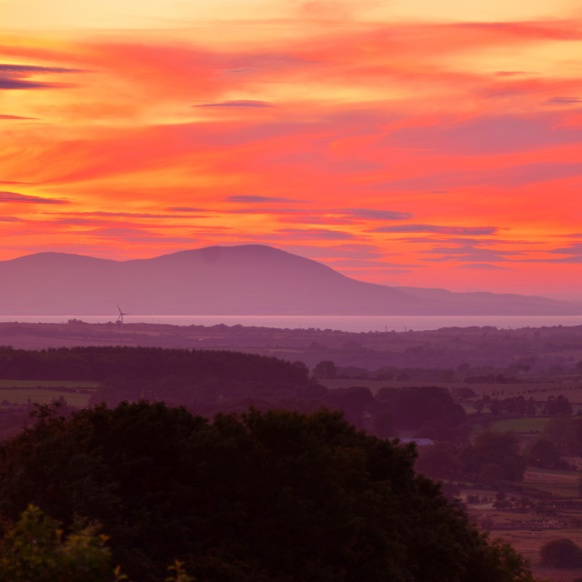 """Sunset over South West Scotland's Mountains from England"" stock image"