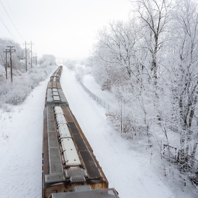 """train passing through fresh snow fall on the tracks"" stock image"