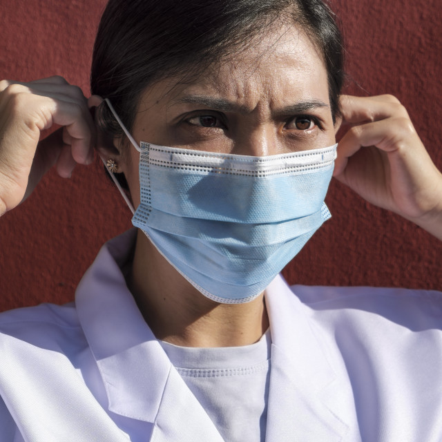 """""""Woman Doctor Wearing Medical Face Mask"""" stock image"""