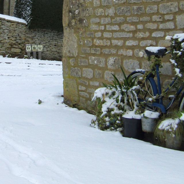 """Old bike in Cotswold snow"" stock image"