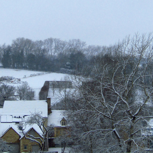 """Cotswold village in Winter snow"" stock image"
