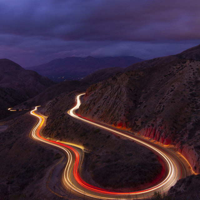 """""""Light trails through a mountain road"""" stock image"""