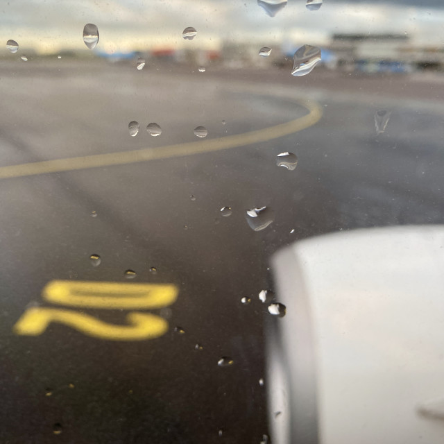"""""""Taxiing at Schiphol airport on a bad weather rainy day."""" stock image"""
