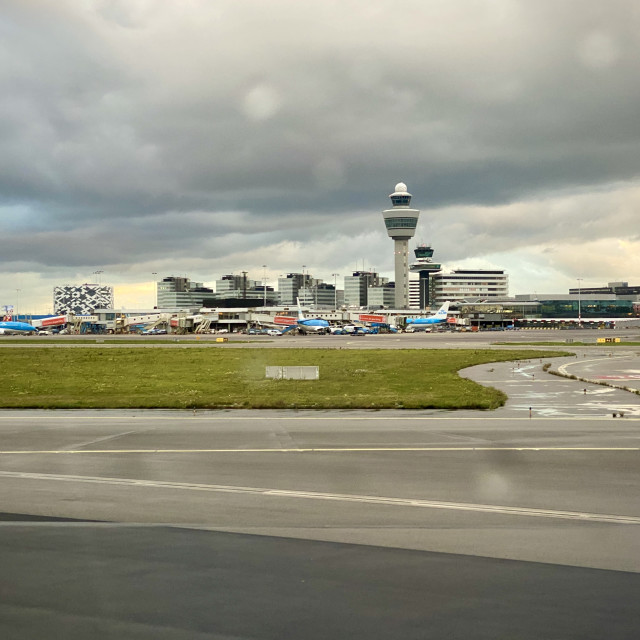 """""""Looking out aircraft window to Schiphol airport."""" stock image"""