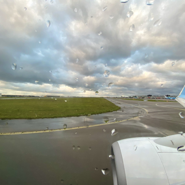 """""""Looking out aircraft window on runway tarmac."""" stock image"""
