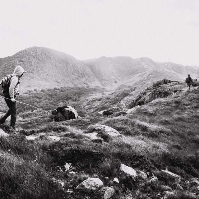 """Hiking across mountain tops"" stock image"