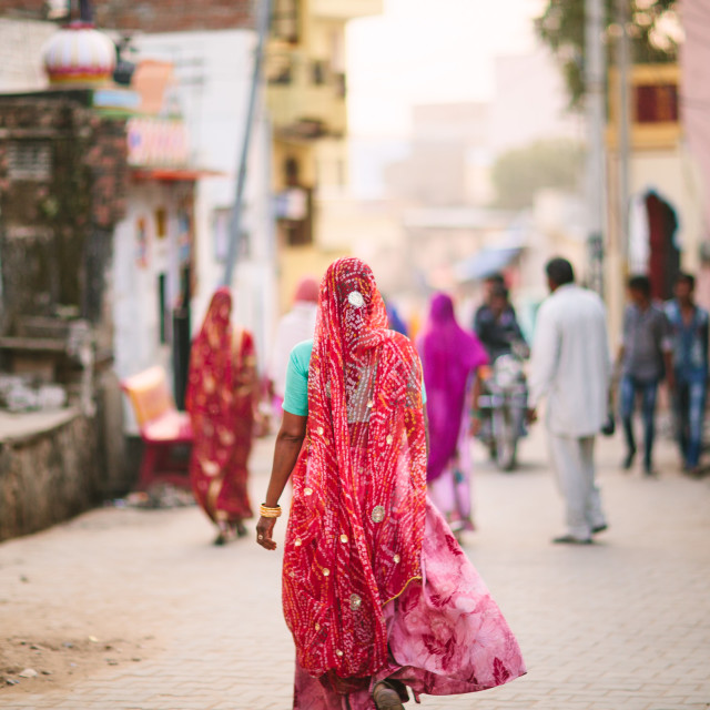 """Woman walking on Indian Street"" stock image"