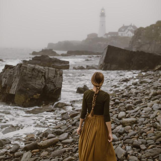 """Woman Lighthouse Fog"" stock image"