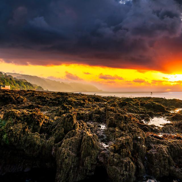 """Sunrise from Kingsand beach, Cornwall, UK."" stock image"
