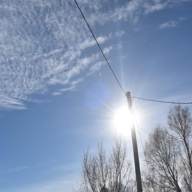 """Winter sky with sun"" stock image"