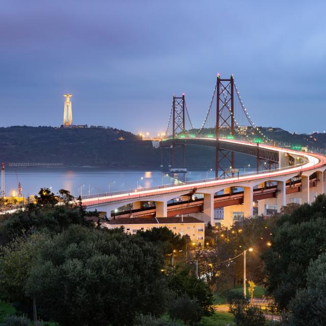 """The 25th April bridge and the Christ the King (Cristo Rei) sanctuary taken at dusk, Lisbon, Portugal"" stock image"