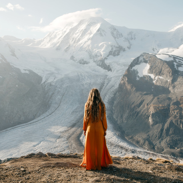 """""""Woman Looking Out Over Glacier"""" stock image"""