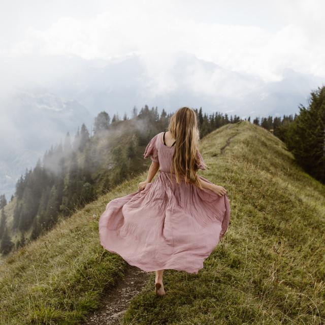 """Women Running Barefoot in Mountains"" stock image"