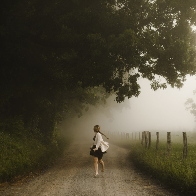 """""""Woman on Country Road on Foggy Morning"""" stock image"""