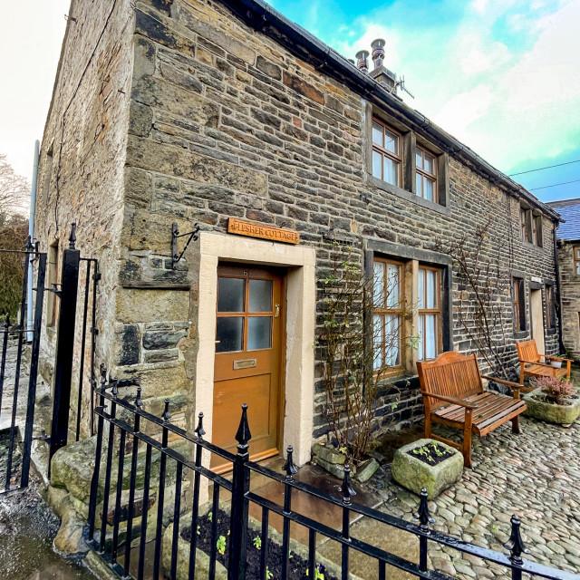 """Flesher Cottage next to Silsden Beck, Silsden (Cobbydale) Yorkshire, England."" stock image"