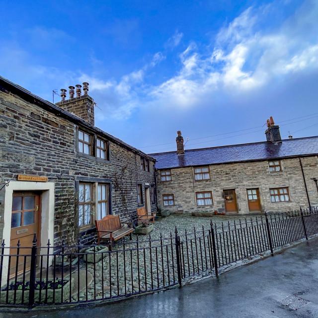 """Cottages next to Silsden Beck, Silsden (Cobbydale) Yorkshire, England."" stock image"