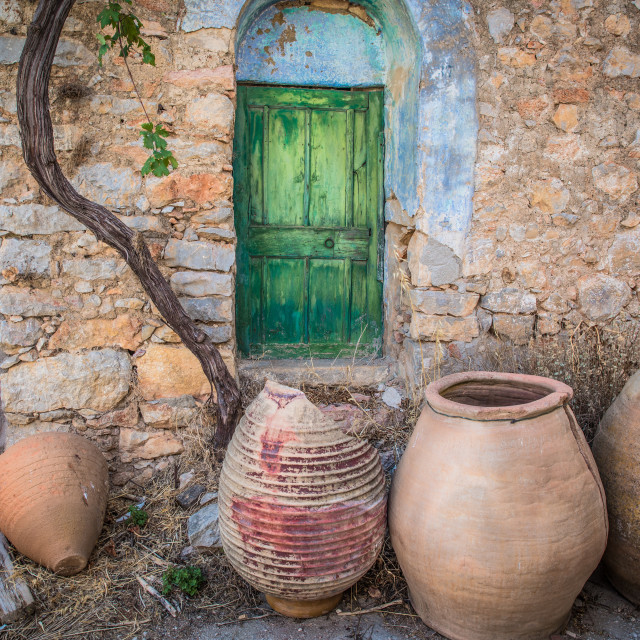 """""""""""Wine, Oil, And Resin"""" - Broken ceramic pots in front of old abandoned village house in Greece"""" stock image"""