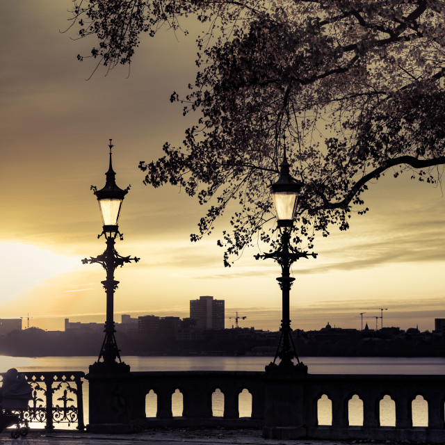 """""Evening Walk"" - Woman enjoying the sunset over Alster Lake in Hamburg"" stock image"