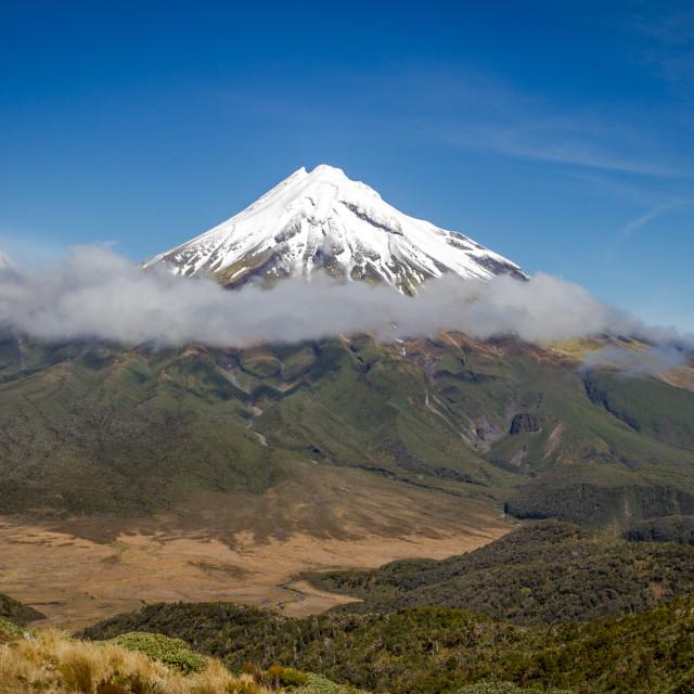 """New Zealand's Mount Taranaki as seen from The Pouakai rangers on a sunny day"" stock image"