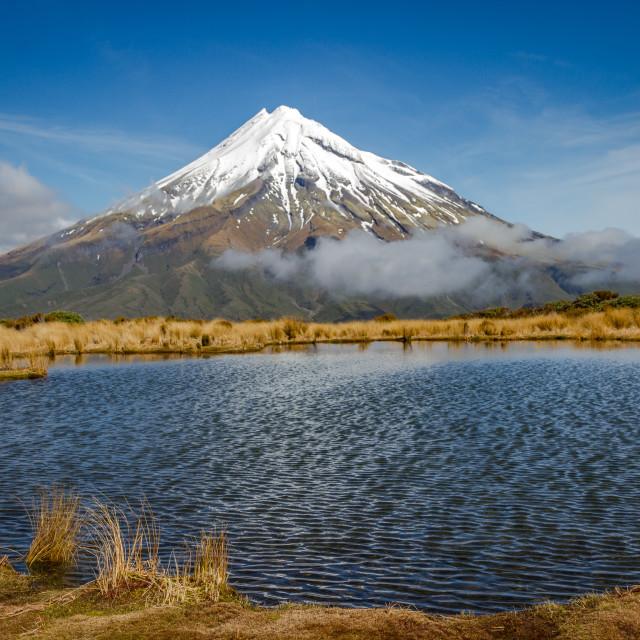 """New Zealand's Mount Taranaki as seen from The Pouakai Tarn on a sunny day"" stock image"