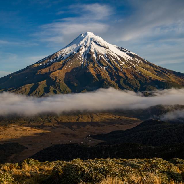 """Mount Taranaki looking from Pouikai Rangers at sunrise"" stock image"