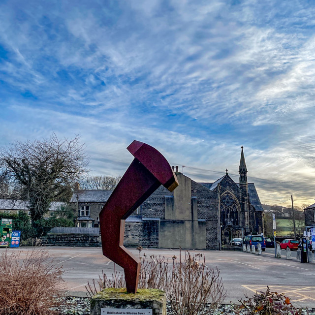 """""""Sculpture on plinth Dedicated to Silsden Town by the artist Sam Shendi, celebrating the Industrial History of Nail Making."""" stock image"""