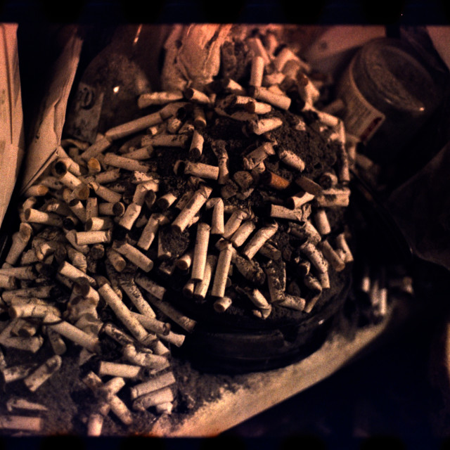 """""""Cigarette ashtray overflowing"""" stock image"""