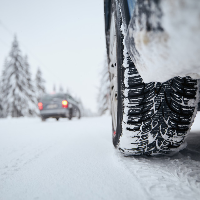 """""""Tire of car on snow covered and icy road"""" stock image"""