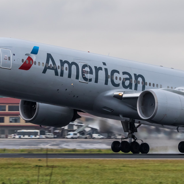 """""""Boeing B777 American Airlines N762AN takeoff at Madrid."""" stock image"""