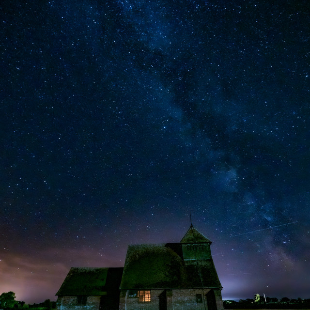 """Milky way over St Thomas a Beckett Church"" stock image"