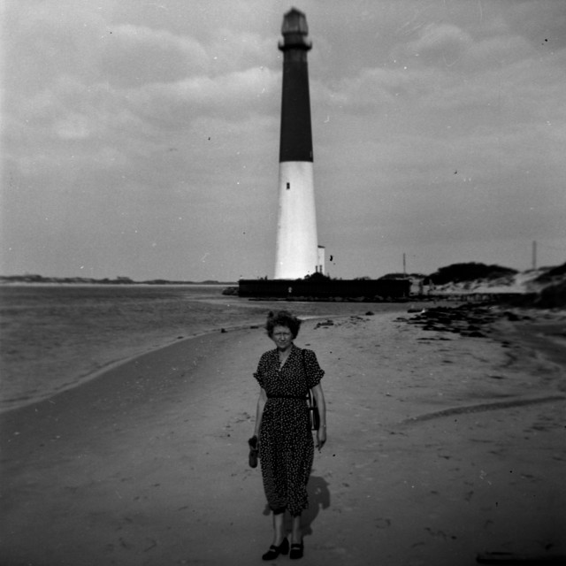 """""""Woman posing in front of an old light house"""" stock image"""