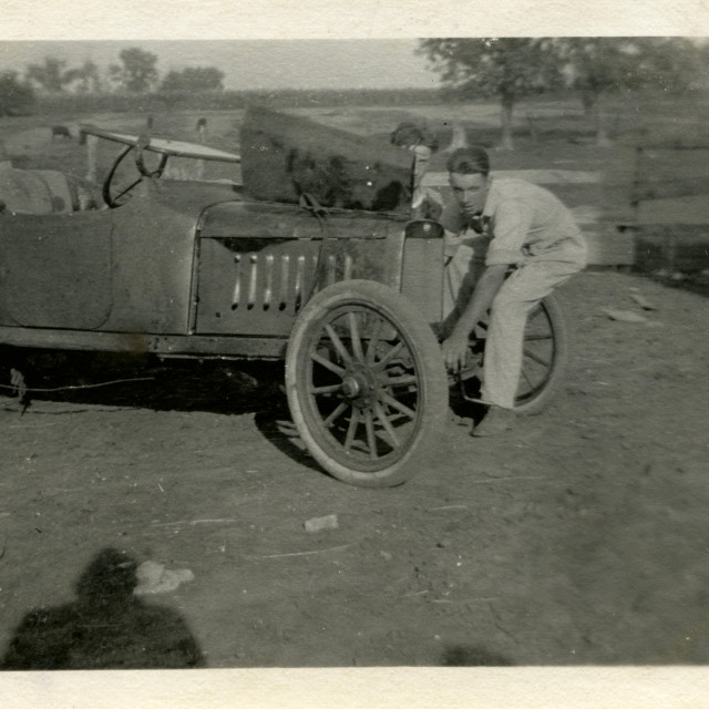 """""""Jesse Reed working on an old car"""" stock image"""