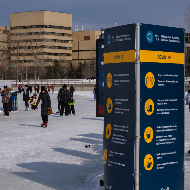 """""""COVID-19 signs on the RIdeau Canal Skateway, Ottawa"""" stock image"""