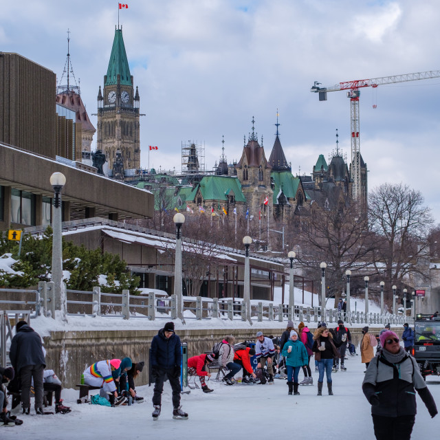"""""""Ice skaters lace up on the RIdeau Canal"""" stock image"""