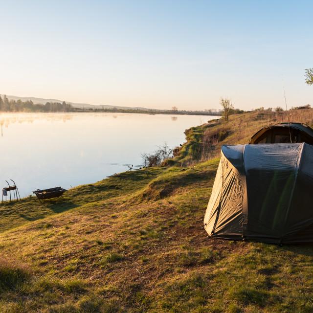 """Fishing adventures. Carp fishing at sunset."" stock image"