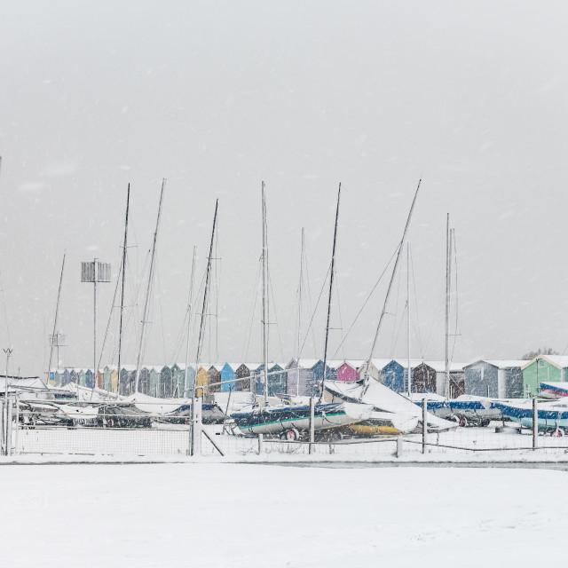 """""""Beach huts and a boatyard"""" stock image"""
