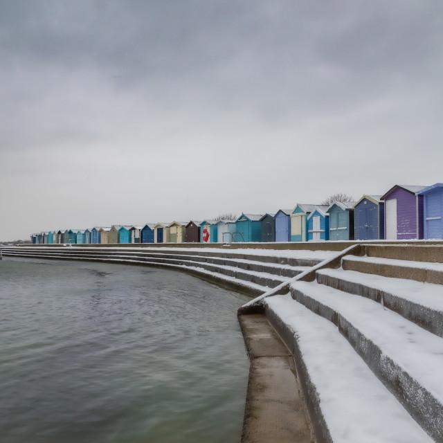 """Beach huts on a snowy promenade"" stock image"