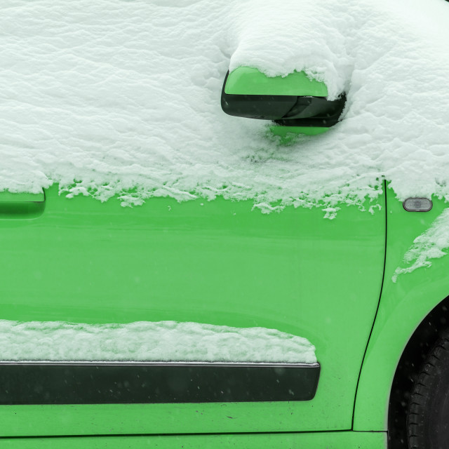 """""""Green car under the snow"""" stock image"""