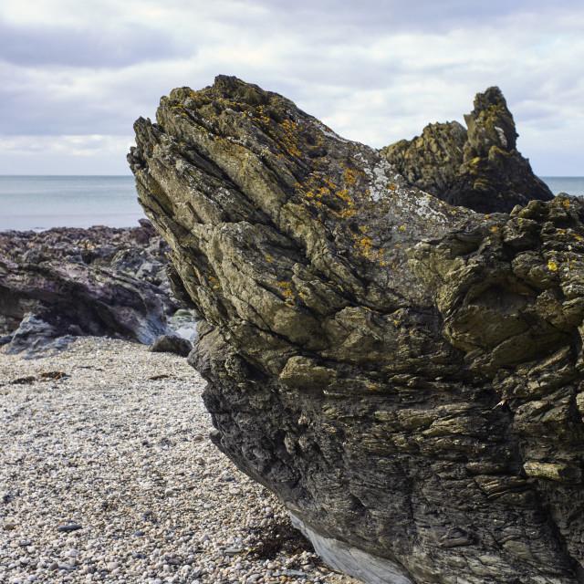 """Jagged rocks on the beach"" stock image"