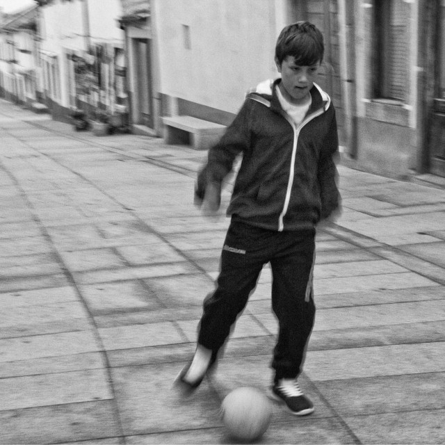 """""""Young boy playing football"""" stock image"""