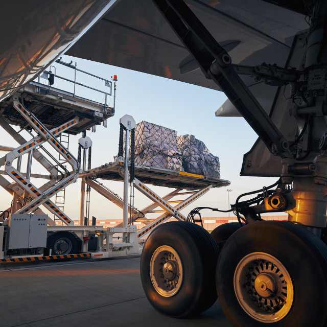 """""""Loading of cargo containers to freight airplane"""" stock image"""
