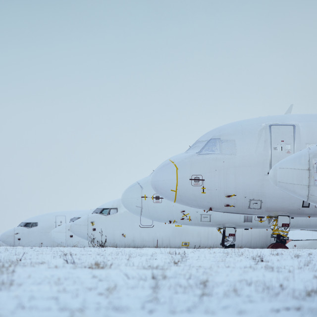 """""""Grounded airplanes in row at airport"""" stock image"""