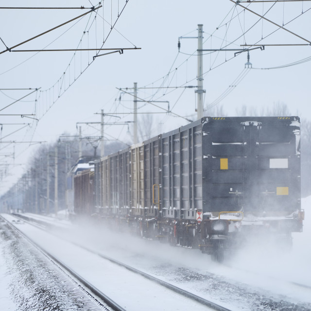 """""""Freight train on snowy railroad track"""" stock image"""