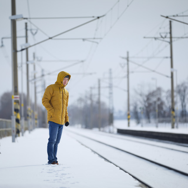 """""""Man standing on platform and waiting for delayed train"""" stock image"""