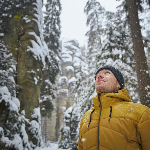 """""""Portrait of young man in winter nature during snowing"""" stock image"""