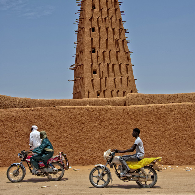"""Agadez mosque with motorbikes; Niger"" stock image"