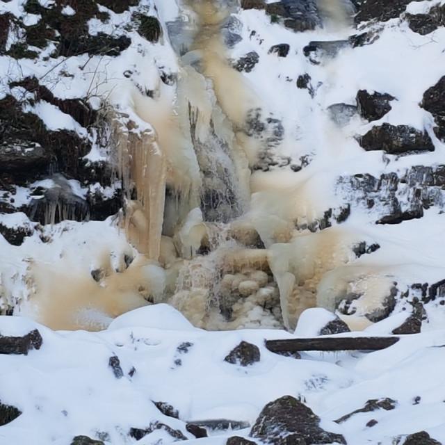 """Frozen waterfall in Pentland Hills, Scotland"" stock image"
