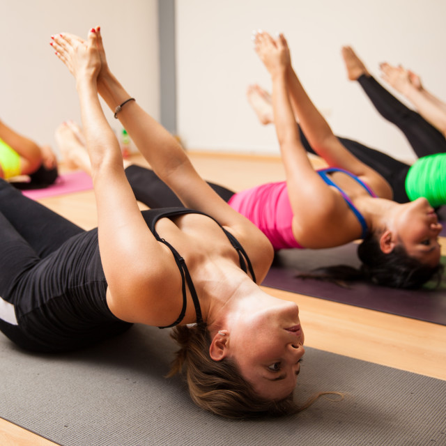 """""""Group of women during yoga class"""" stock image"""