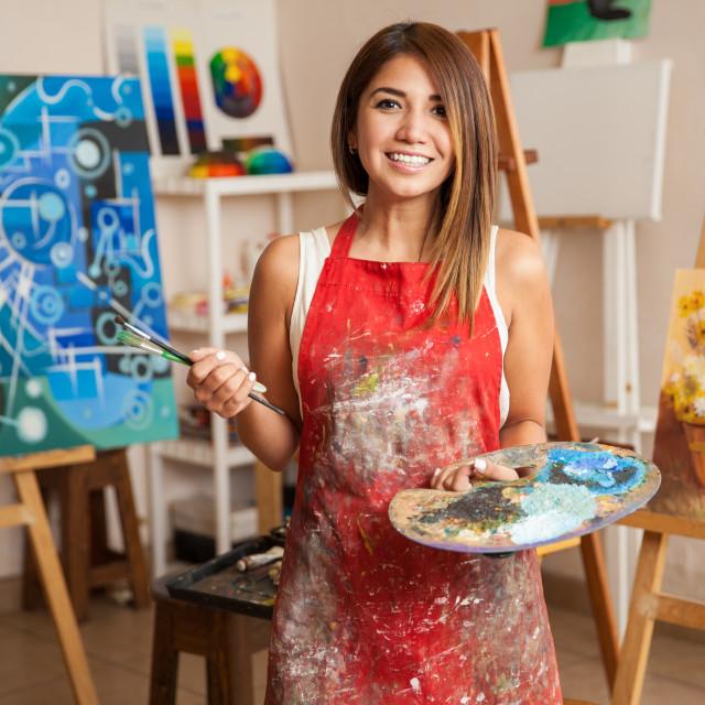 """Beautiful female artist in her studio"" stock image"